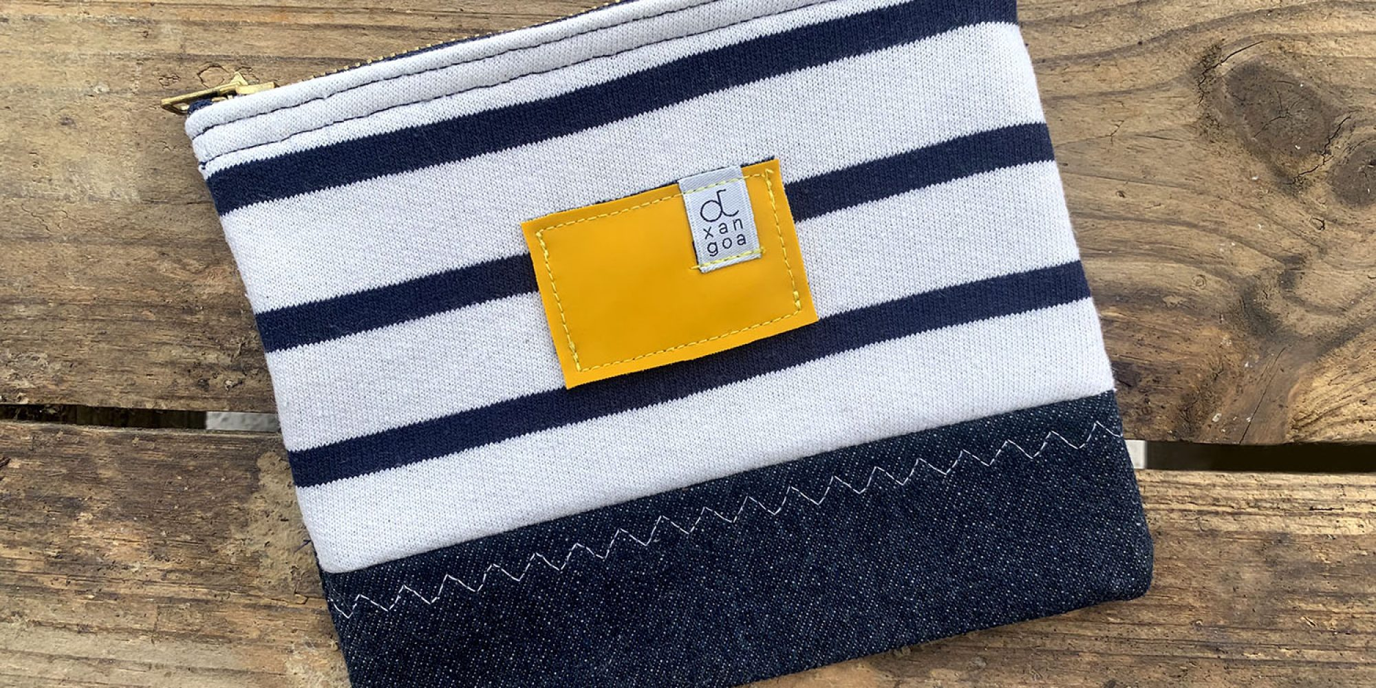 The Maïka pouch from Otxangoa is made from jeans, sailor tops and oilskins at the end of their life. Eco-designed and Made in France !